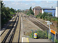 Dist:0.1km<br/>Looking west from the footbridge. The freight lines are on the right, and at this point merge into a single track to pass behind the station platform.