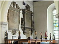 TQ4483 : Eight statuettes on the screen outside the clergy vestry, St Margaret's Church by Mike Quinn