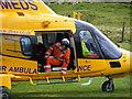 SJ9978 : Air ambulance landing below Windgather Rocks by Phil Champion