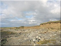 SH3368 : Wave-cut platform and eroded boulder clay cliffs in Porth Cwyfan by Eric Jones