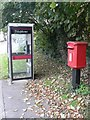 SU0726 : Bishopstone: postbox № SP5 316 and phone by Chris Downer