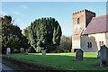 SE9949 : The Churchyard, All Saints Kilnwick by Peter Church
