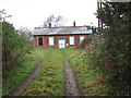 TG2528 : Disused railway station by the Weavers Way by Evelyn Simak