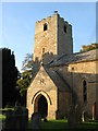NY9166 : The tower and porch of St. Michael's Church, Warden by Mike Quinn