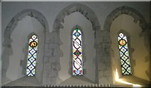SU8014 : Stained glass windows above the altar at St Peter, East Marden by Basher Eyre
