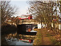 TQ1178 : Grand Union Canal bridge 201 Hayes Road - with bus by David Hawgood