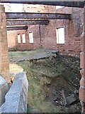 SH4094 : The collapsed floor of the Porth Wen Brick Work's workshop by Eric Jones