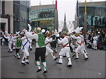 SP0786 : View of St Martins, The Bull Ring from High Street with Morris Dancers by Roy Hughes