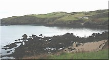 SH4094 : Sandy beach and reefs at the head of Porth Wen bay by Eric Jones