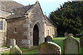 SO4402 : St Tysoi's Church - porch and churchyard by Ruth Sharville