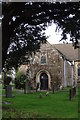 ST4793 : Porch and churchyard, St. Thomas a Becket's church, Shirenewton by Ruth Sharville
