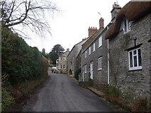 ST5707 : Melbury Osmond: main street through village by Chris Downer