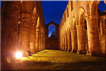 SE2768 : The nave, Fountains Abbey at dusk by Alan Ford