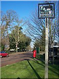 TQ7057 : East Malling Village Sign on New Road by David Anstiss