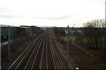 SJ5990 : West Coast Main Line, looking South from Cromwell Avenue at Winwick Quay by David Long