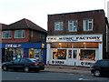 SZ0796 : Betting shop next to music shop, Kinson by Jonathan Billinger