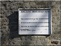 SP9277 : Sign on Cranford St Andrews Dovecote by Michael Trolove