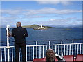 NM7734 : Lighthouse on the SW tip of Lismore - from the Mull ferry by Ian Cunliffe