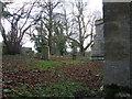 TL1071 : Bench Mark On Stow Longa Church by Michael Trolove
