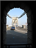 SH5571 : Pont y Borth through the arch of the southern chain anchor house by Eric Jones