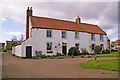 NU1241 : Cottages, Holy Island, Northumberland by Christine Matthews