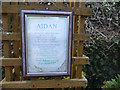 NU1241 : Plaque about St Aidan, Gospel Gardens, Holy Island by Christine Matthews