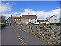 NU1241 : Village on Holy Island, Northumberland by Christine Matthews