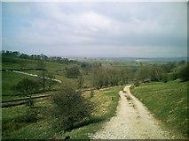 SD9657 : Access track down to railway near Rylstone by Rob Bainbridge