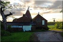 TQ6049 : Sun setting behind the Oast house, Grange Farm by N Chadwick