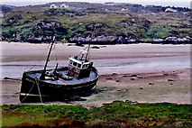 B7318 : The Rosses - Fishing boat grounded at Cruit Island by Joseph Mischyshyn
