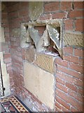NZ3411 : Medieval carvings in the church porch by Gordon Hatton