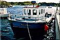 B7923 : Bunbeg - Boat in harbour by Joseph Mischyshyn