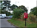SZ0799 : Ferndown: postbox № BH22 82, Ringwood Road by Chris Downer