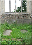 TM1685 : The ruined church of St Mary - ledger slabs on chancel floor by Evelyn Simak