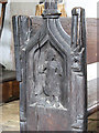 TM1687 : St Margaret's church - C13 bench end by Evelyn Simak