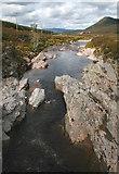NN8596 : River Feshie from bridge looking north by Peter Bond