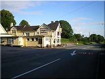 SJ9239 : The George & Dragon and the Rough Close milepost by Richard Law