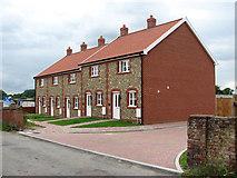 TM0890 : New housing in Marsh Lane by Evelyn Simak