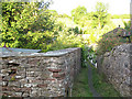 NY7808 : Narrow passage in Hartley village by Stephen Craven