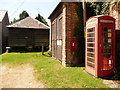 SY8985 : East Holme: postbox № BH20 91 and phone by Chris Downer
