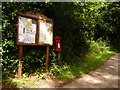 SY7483 : Upton: postbox № DT2 154 and noticeboard by Chris Downer