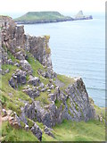 SS4088 : Cliffs by Old Castle by Colin Smith