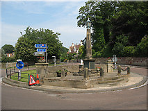 NU2410 : Roundabout with war memorial by Stephen Craven
