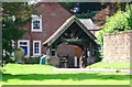 NY4654 : Lych Gate at Wetherall Church by Eric Rosie