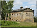 NZ0878 : The east wing of the stables at Belsay Hall by Mike Quinn