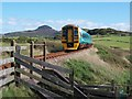 SH5137 : The Arriva Wales train to Pwllheli approaching the Graig-Ddu pedestrian crossing by Eric Jones