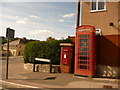 SY3492 : Lyme Regis: postbox № DT7 33 and phone, Summerhill Road by Chris Downer