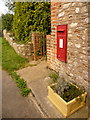 SY3999 : Bettiscombe: postbox № DT6 12 by Chris Downer