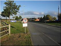 SJ3464 : Road into Broughton Shopping Park by John S Turner