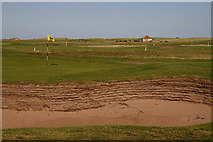 NU0445 : The 18th green at Goswick Golf Course by Walter Baxter
